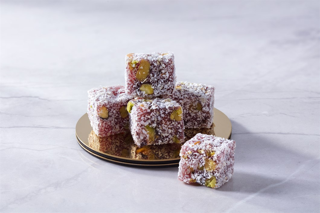 COCONUT COVEREDTURKISH DELIGHT WITH PISTACHIO AND POMEGRANATE COVERED COCONUTS KG